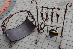 Blacksmith set of fireplace accessories with a firewood unit