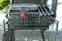 Barbeque with an integrated meat smoking facility, stationary