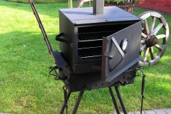 Barbeque with a mini integrated meat smoking facility